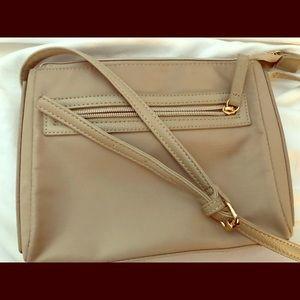 Handbags - Cross body purse with pocket and zipper.